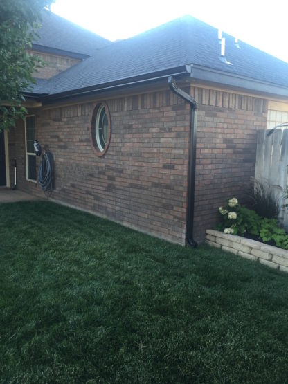 Black 5 Inch with 2x3 gutters and Downspouts side